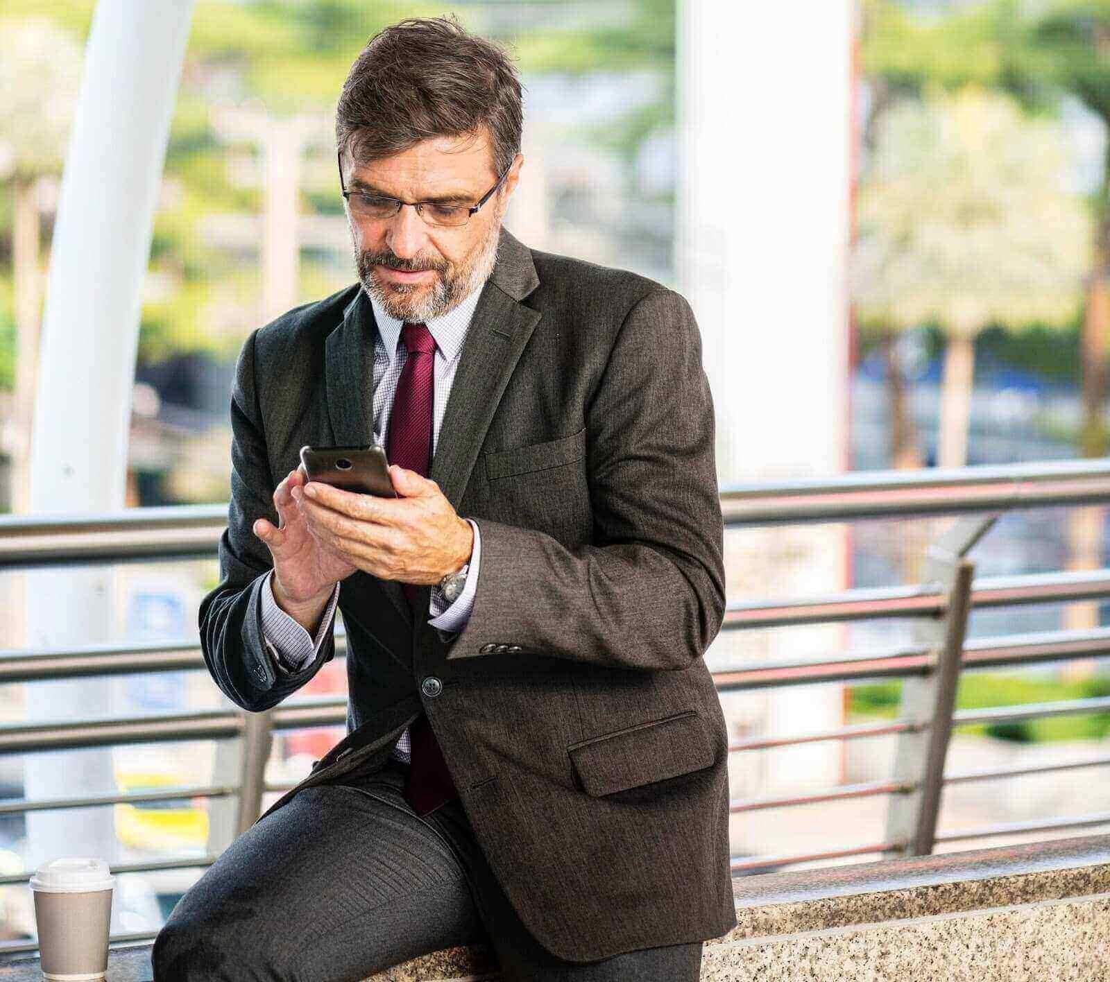 Computer Repair Palm Beach Senior with phone looking up Ballard computer service areas